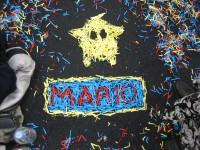 Mario and a super star drawn using confetti